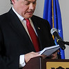 David Henneke, Woodring Wall of Honor board president reads the names of 72 northwest Oklahoma military servicemen who lost their lives during the Vietnam War Friday at Convention Hall. The American Veterans Traveling Tribute Wall bearing their names was purchased and will be permanently installed at Woodring Regional Airport. (Staff Photo by BONNIE VCULEK)