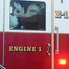 Santa waves from inside Enid Fire Department Engine 1 Friday as he arrives at Oakwood Mall. (Staff Photo by BONNIE VCULEK)