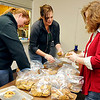 (Left to Right) Sandi Wilson, Melissa James and Cary Robinson bags cookies Tuesday as part of Operation Cookie Cutter. Volunteers baked cookies to send to troops from Vance Air Force Base deployed overseas. (Staff Photo by BILLY HEFTON)