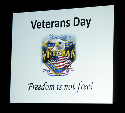 """A special """"Proud to be a Veteran"""" slide proclaims that """"Freedom is not free!"""" Friday during the Prairie View Elementary School Veterans Day Assembly. (Staff Photo by BONNIE VCULEK)"""