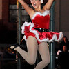 A Dance Works entertainer leaps into the air during a performance at the Garfield County Court House lawn gazebo Friday at Enid Lights Up the Plains. (Staff Photo by BONNIE VCULEK)