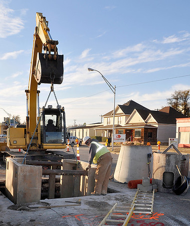 A crew from Luckinbill work on repairing a sewer line on west Broadway Monday. (Staff Photo by BILLY HEFTON)