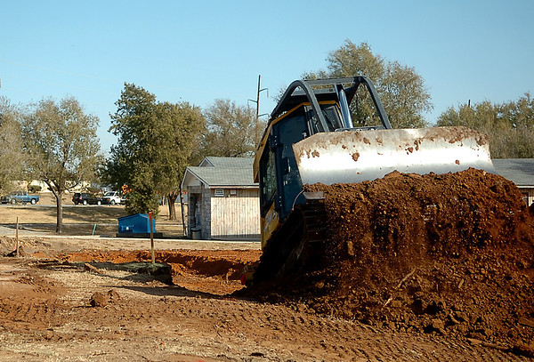 A bulldozer does dirt work Monday for the carousel at Meadowlake Park.(Staff Photo by BILLY HEFTON)