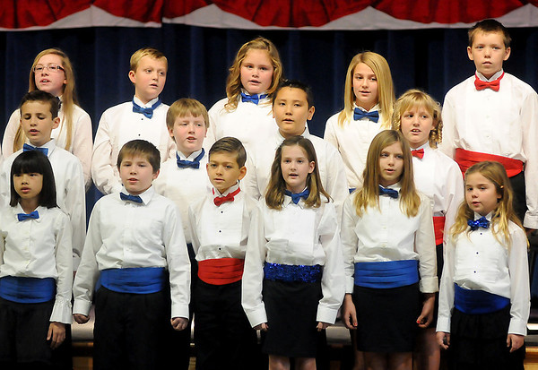 Members of the Prairie View Elementary School honor choir perform a Tribute to the Armed Forces Friday during the Veterans Day Assembly. (Staff Photo by BONNIE VCULEK)
