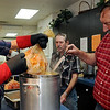 Leroy and Al Patocka drain the juices from a turkey-filled oven bag Wednesday as the Knights of Columbus prepares the meat for the annual Thanksgiving Day meal at St. Francis Xavier Catholic Church. (Staff Photo by BONNIE VCULEK)