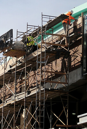 A worker prepares the exterior for brick at the Renaissance project construction site Wednesday. (Staff Photo by BONNIE VCULEK)