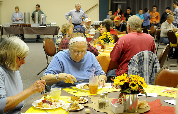 Enid residents dine on turkey, dressing, mashed and sweet potatoes, gravy, green beans, dinner rolls and dessert Thursday during the annual Thanksgiving Day meal at the First Baptist Church, 401 W. Maine. (Staff Photo by BONNIE VCULEK)