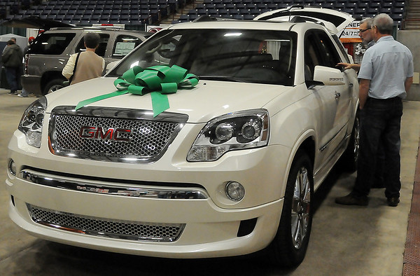 Guests consider a vehicle purchase during Home for the Holidays Saturday at the Chisholm Trail Coliseum. The show continues today from 11 a.m.-5 p.m. (Staff Photo by BONNIE VCULEK)