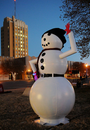 A giant snowman greets the guests during Enid Lights Up the Plains Friday. (Staff Photo by BONNIE VCULEK)