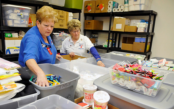 Brenda Bingham and Jolene Taylor fill a box with items donated to the Blue Star Mother organization. (Staff Photo by BILLY HEFTON)
