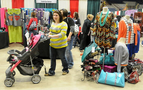 Guests shop for gifts during Home for the Holidays at the Chisholm Trail Coliseum Saturday. The annual show continues today from 11 a.m.-5 p.m. (Staff Photo by BONNIE VCULEK)