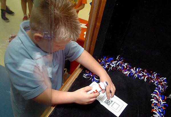 Adams Elementary kindergartner, Kaden Zirkel, prepares to cast his vote for either Duck or Grace. (Staff Photo by BILLY HEFTON)