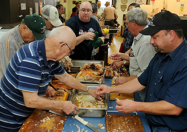 The Knights of Columbus prepare and de-bone 19 turkeys Wednesday for the free Thanksgiving Day meal. Turkey, dressing potatoes, gravy, green beans, corn, rolls, salad and dessert will be served from 11 a.m.-1 p.m. in the Leven Center dining room at St. Francis Xavier Catholic Church. The free meal will also be available at the First Baptist Church from 11 a.m.-1 p.m. and the Salvation Army of Enid will host dinner at 6 p.m. (Staff Photo by BONNIE VCULEK)