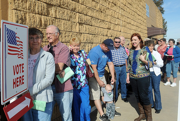 Garfield County residents line up outside the Garfield County Election Board office Friday at 903 Failing, as registered voters across Oklahoma hope to avoid long wait times by casting their ballots early. (Staff Photo by BONNIE VCULEK)