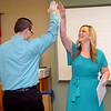 Glenwood Elementary music teacher, Lindsey Schroder, gets a high five from principal, Jim Rainey, after being awarded a grant from the Enid Public School Foundation Tuesday. (Staff Photo by BILLY HEFTON)