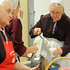 Oklahoma Mennonite Relief Sale volunteers serve homemade ice cream to guests Saturday at the Chisholm Trail Expo Center Pavilion. Proceeds from the event fund disaster relief around the world. (Staff Photo by BONNIE VCULEK)
