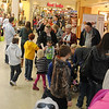 Holiday shoppers move through Oakwood Mall as they search for Black Friday bargains and wait for Santa's arrival with their children and grandchildren. (Staff Photo by BONNIE VCULEK)