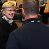 The Honorable Linda Pickens (left) congratulates Joshua Allison after Judge Pickens swears four new officers into duty for the Enid Police Department Thursday at the City of Enid Council Chambers.  Allison, Michele James, Vladimir Iglesias and Earl Smith III will continue their intense training for their new positions. (Staff Photo by BONNIE VCULEK)