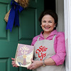 Sherrel Jones, editor of the Junior Welfare League Stir Ups Cookbook,  pauses at the entrance of her Elmstead home Saturday. On Nov. 15 the Enid organization will celebrate the 30th anniversary of the publication in the home of Sherrel and Stephen Jones, 8214 N. U.S. 81. (Staff Photo by BONNIE VCULEK)