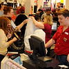 J.C.Penney customer service representatives assist holiday shoppers at Oakwood Mall Friday. (Staff Photo by BONNIE VCULEK)