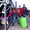 Members of the Enid High School marching band load their luggage onto a bus as they prepare to depart for Chicago where they will be marching in the McDonald's Thanksgivings Day Parade. (Staff Photo by BILLY HEFTON)