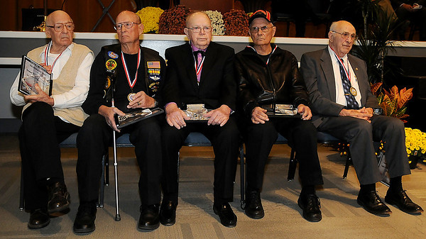 """Orleau """"Orlo"""" Marlatt, Lonnie Gillespie, Rex Campbell, Arlo Becker and Tom Lamunyon were recognized as Legacy Veterans of the Year during a special ceremony at Convention Hall Sunday. (Staff Photo by BONNIE VCULEK)"""
