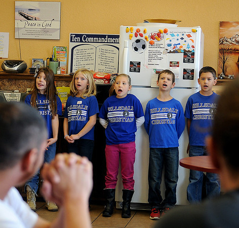 Second grade students from Hillsdale-Christian School sing at the Hope Outreach homeless shelter Tuesday. (Staff Photo by BONNIE VCULEK)