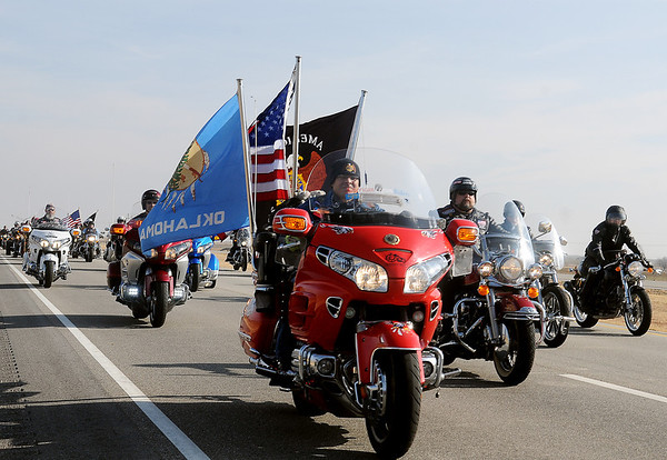 """Veterans fly patriotic colors as they begin the final few miles into Enid for the Woodring Wall of Honor """"Welcome Home"""" ceremony for the American Veterans Traveling Tribute honoring Vietnam Veterans Friday. (Staff Photo by BONNIE VCULEK)"""