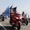 "Veterans fly patriotic colors as they begin the final few miles into Enid for the Woodring Wall of Honor ""Welcome Home"" ceremony for the American Veterans Traveling Tribute honoring Vietnam Veterans Friday. (Staff Photo by BONNIE VCULEK)"