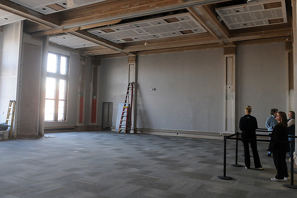 Guests tour the Convention Hall Junior Ballroom Sunday during the grand re-opening and veterans day ceremony. Construction is a work in progress at the Renaissance project facility in downtown Enid. (Staff Photo by BONNIE VCULEK)