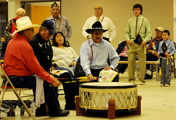 Drummers (front, from left) Wilkie Eagle, Douglas Eagle and John McIntosh set the beat during the Enid Inter-Tribal Indian Club Gourd Dancing Saturday at the Hoover Building. (Staff Photo by BONNIE VCULEK)