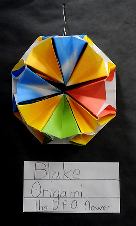 An origami U.F.O flower design by Blake, a Monroe Elementary School student, appears in the Park Avenue Thrift art exhibit Wednesday. (Staff Photo by BONNIE VCULEK)