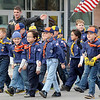 Boy Scouts of America and their troop leaders participate during the Veterans Parade Sunday in downtown Enid. (Staff Photo by BONNIE VCULEK)