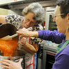 Shirley Patocka (left) and Elaine Mahl transfer apricot filling into a larger stock pot Friday as they prepare kolaches for the Ladies Auxiliary fundraiser at Our Daily Bread Friday and Saturday. The local organization bakes 65-70 pecan pies, 35 pumpkin pies, and a apricot, peach, prune, cherry and poppyseed kolaches for their annual event. (Staff Photo by BONNIE VCULEK)