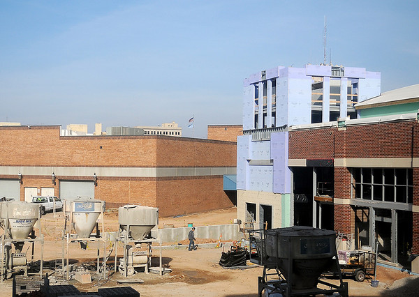 Renaissance Project workers continue construction on the new Enid Event Center Friday. (Photo by BONNIE VCULEK)