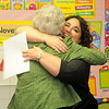 Kremlin-Hillsdale Elementary School pre-k instructor, Heather Carson (right) hugs Beverly Voth after Carson receives a grant from the Kremlin-Hillsdale Academic Enrichment Foundation Wednesday. The foundation awarded a total of $11,200 as members honored every grant requested by teachers this year. (Staff Photo by BONNIE VCULEK)