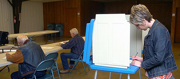 Deirdre Postier votes Tuesday at the Breckinridge Community Center. Nearly thirty percent of the precinct's eligible had voted by 10 a.m. (Staff Photo by BILLY HEFTON)