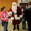 Adoring fans greet Santa at Oakwood Mall Friday. (Staff Photo by BONNIE VCULEK)