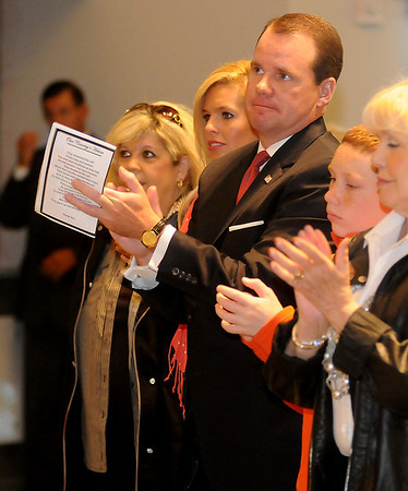 Lt. Gov. Todd Lamb (center) and his family applaud during the Legacy Veterans Award Ceremony Sunday at Convention Hall. (Staff Photo by BONNIE VCULEK)