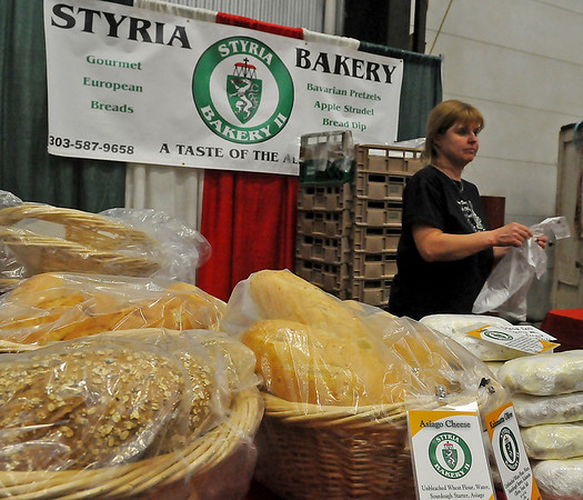 Roasted garlic, multi-grain, asiago cheese, kalematto olive light sour dough breads are available from Shannon Campbell (right) at Styria Bakery during Home for the Holidays at the Chisholm Trail Expo Center Saturday and Sunday. (Staff Photo by BONNIE VCULEK)