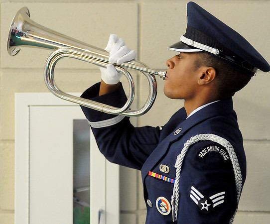 """Vance Air Force Base Silver Talons Honor Guard member plays """"TAPS"""" during Prairie View Elementary School's Veterans Day Assembly Friday. (Staff Photo by BONNIE VCULEK)"""