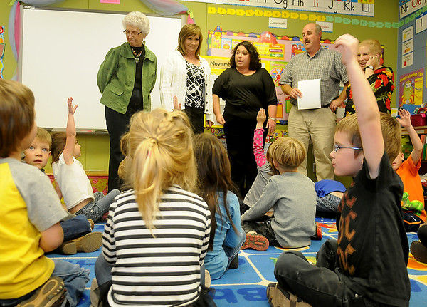 Pre-K students answer a question for their teacher, Heather Carson (top, center), as members of the Kremlin-Hillsdale Academic Enrichment Foundation award 100% of the grants requested Wednesday afternoon. A total of $11,200 was distributed to 11 different instructors. (Staff Photo by BONNIE VCULEK)