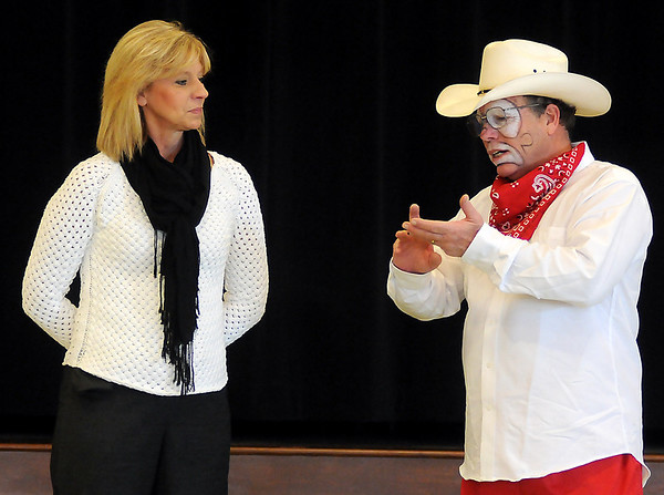 Garfield Elementary School assistant principal Carolyn LaBrue (left) listens as PBR Bull Riding rodeo clown Marvin Nash asks her to think of a time that she was hurt by someone else during an anti-bullying presentation at Garfield Elementary School. It took LaBrue less than one second to respond to Nash's request. Nash has been traveling to all area schools encouraging students to prevent or stop bullying. (Staff Photo by BONNIE VCULEK)