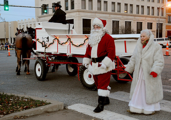Santa and Mrs. Claus arrive in a horse-drawn wagon during Enid Lights Up the Plains on the Garfield County Courthouse lawn Friday, Nov. 29, 2013. (Staff Photo by BONNIE VCULEK)