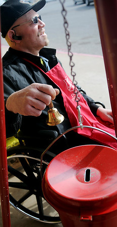 Anthony Dixson rings a bell for Salvation Army red kettle donations at the Big K-Mart Wednesday, Nov. 20, 2013. Dixson has assisted the Salvation Army on and off for seven years. (Staff Photo by BONNIE VCULEK)