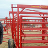 R.L. Wilson, General Manager for Burlington Welding, LLC in Cherokee, stands next to the 1,000th portable corral designed and rolled out by Diamond W Corral Friday, Nov. 22, 2013. The round corral saves ranchers time with set up on various types of terrain. (Staff Photo by BONNIE VCULEK)