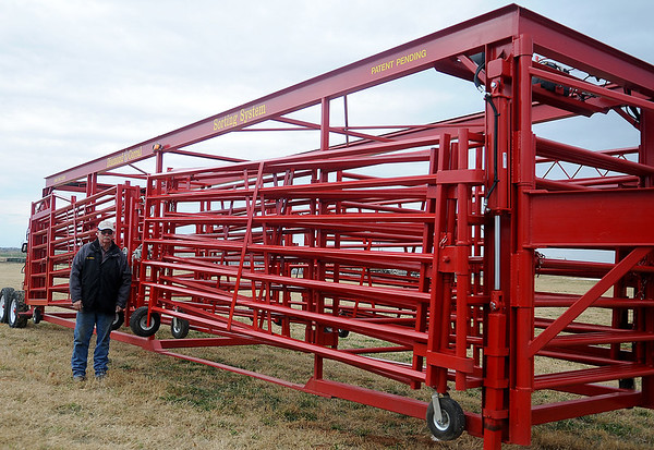 R.L. Wilson, General Manager for Burlington Welding, LLC in Cherokee, Okla., stands next to a Diamond W Corral Sorting System. The goose-neck unit splits into two pieces for access in or out of the front with a center alley way used for sorting cattle or horses. (Staff Photo by BONNIE VCULEK)