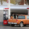 A gentleman fills his Ford Ranger pickup with gasoline at the Conoco on S. Van Buren as a truck delivers additional fuel to the business Wednesday, Nov. 20, 2013. As an added precaution during the winter months, drivers should perform regular maintenance checks on their vehicles. (Staff Photo by BONNIE VCULEK)