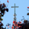Birds rest atop the cross on the St. Francis Xavier Catholic Church steeple as it towers above colorful trees Tuesday, Nov. 12, 2013. (Staff Photo by BONNIE VCULEK)