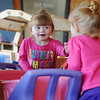 Jacey Mitchell reacts as she sees her reflection during a special playtime with her mom, Chelsey, at CDSA Friday, Nov. 1, 2013. The Mitchell family participates in CDSA's Parents as Teachers program. CDSA recently received a grant that will provide three new parent educators. (Staff Photo by BONNIE VCULEK)